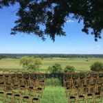 Wisconsin Wedding Venue - Vennebu Hill events barn in Wisconsin Dells - ceremony outside location and gold chateau chair