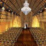 Wisconsin Wedding Venue - Vennebu Hill events barn in Wisconsin Dells - ceremony barn and gold chateau chair
